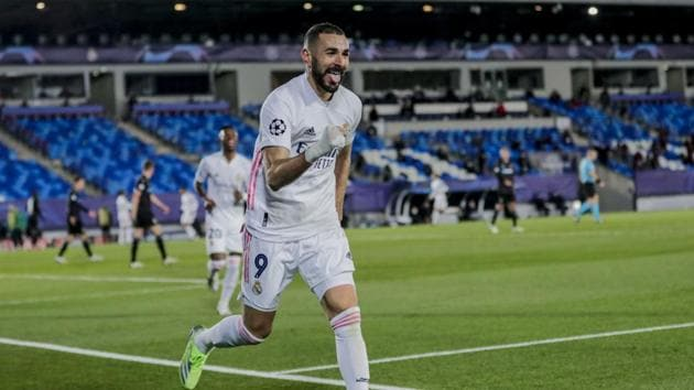Karim Benzema celebrates after scoring his side's second goal during the Champions League group B soccer match between Real Madrid and Borussia Monchengladbach at the Alfredo Di Stefano stadium in Madrid, Spain.(AP)