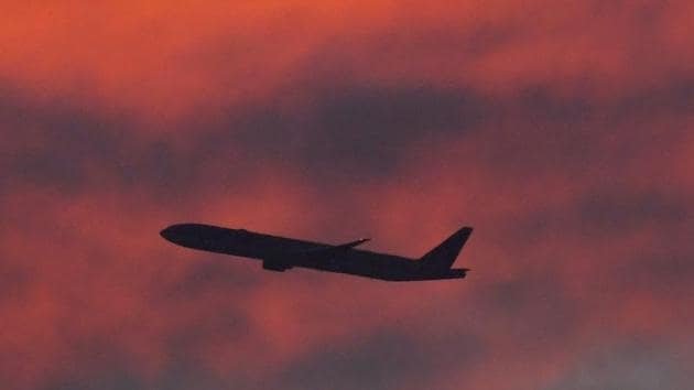 A plane is seen shortly after take-off at sunset, from Heathrow Airport, London, Britain.(REUTERS)