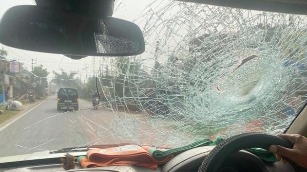 A vehicle of BJP National President JP Nadda's convoy damaged after stone-pelting by alleged TMC activists at Diamond Harbour, in South 24 Pargana.(ANI)