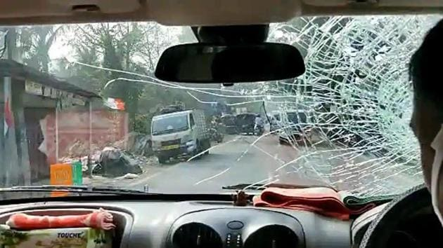 A vehicle of BJP National President JP Nadda's convoy damaged after stone-pelting by alleged TMC activists at Sirakal near Diamond Harbour, in South 24 Pargana.(ANI Photo)