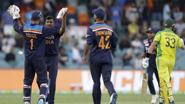 India's Thangarasu Natarajan, second left, is congratulated by teammate India's K.L. Rahul(AP)