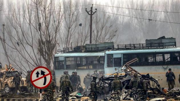 Security personnel carry out the rescue and relief works at the site of suicide bomb attack at Lathepora Awantipora in Pulwama district of south Kashmir, Thursday, February 14, 2019. At least 30 CRPF jawans were killed and dozens other injured when a CRPF convoy was attacked.(PTI)
