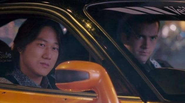Sung Kang and Lucas Black in a still from The Fast and the Furious: Tokyo Drift.