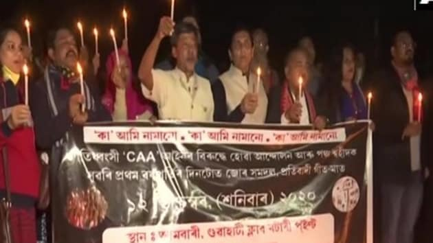 Nagarik Samaj takes out candlelight march against CAA in Assam.(ANI)