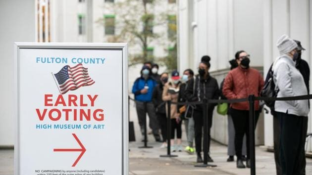 Voters line up for the first day of early voting outside of the High Museum polling station on December 14 in Atlanta, Georgia for a run-off election for two US Senate seats.(AFP)
