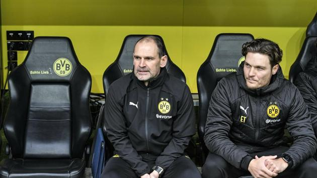 FILE - In this Saturday, Feb. 9, 2019 file photo Dortmund's assistant coaches Manfred Steves, left, and Edin Terzic sit beside the empty seat of head coach Lucien Favre, during the German Bundesliga soccer match between Borussia Dortmund and TSG 1899 Hoffenheim in Dortmund, Germany, . Borussia Dortmund has presented its new coach Edin Terzić. Dortmund fired Lucien Favre on Sunday after his team's 5-1 defeat at home to Stuttgart the day before. (AP Photo/Martin Meissner, file)(AP)