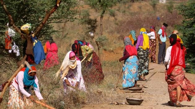 Labourers under Mahatma Gandhi National Rural Employment Guarantee Act (MGNREGA) work at a site, during the Covid-19 lockdown's second phase, on the outskirts of Ajmer.(PTI)