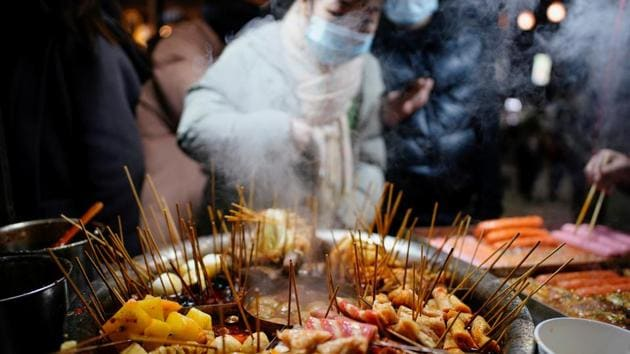 Local snacks are seen at a street market almost a year after the global outbreak of the coronavirus disease in Wuhan, Hubei province.(REUTERS)