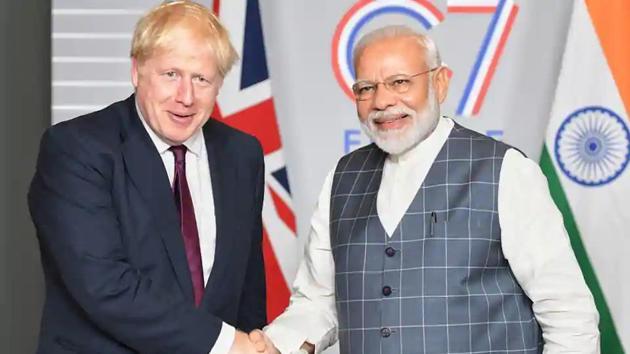 Prime Minister Narendra Modi shakes hands with UK PM Boris Johnson(Photo courtesy: PIB))