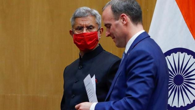 Britain's Foreign Secretary Dominic Raab and India's Foreign Minister Subrahmanyam Jaishankar leave after attending a joint news conference in New Delhi, India, December 15, 2020.(Reuters photo)