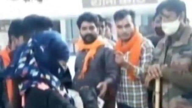 The girl being questioned by members of saffron brigade in presence of policemen. (HT Photo)