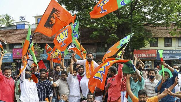 BJP workers celebrate during counting day of Kerala local body elections, in Kozhikode.(PTI file photo)