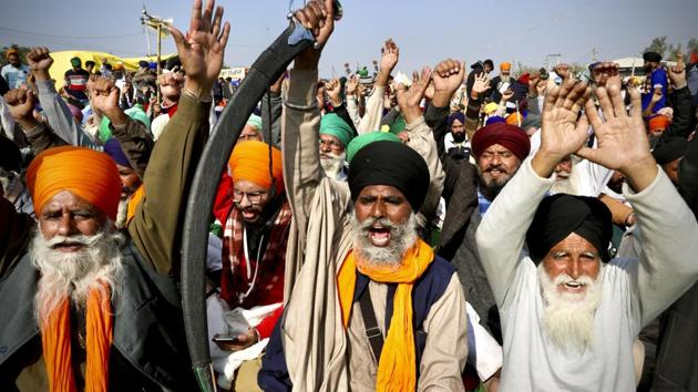 Protesting farmer leaders shout slogans as they sit on a day long hunger strike at the Delhi- Haryana border, outskirts of New Delhi.(AP)