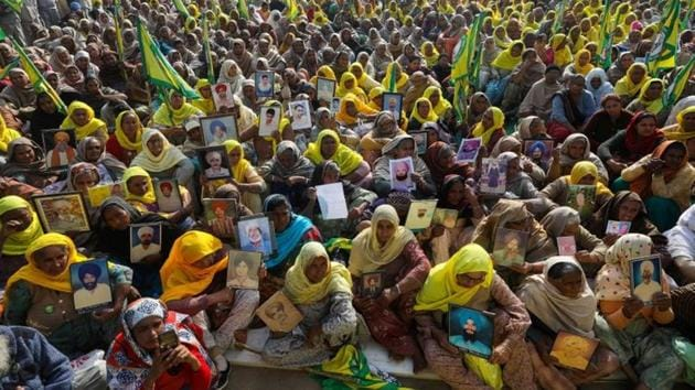 Women, including widows and relatives of farmers who were believed to have killed themselves over debt attend a protest against farm bills passed by India's parliament, at Tikri border near Delhi, India.(REUTERS)
