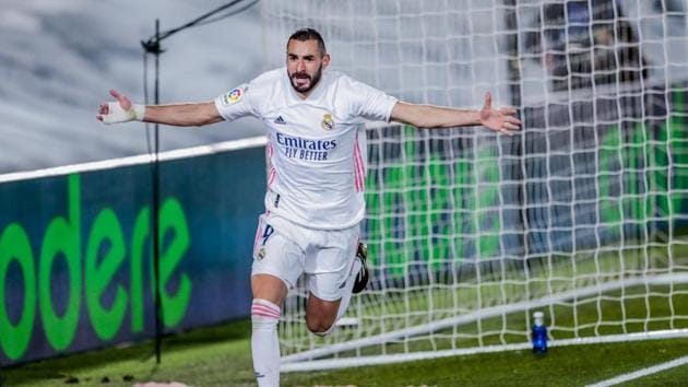 Real Madrid's Karim Benzema celebrates after scoring his side's second goal during the Spanish La Liga soccer match between Real Madrid and Athletic Club Bilbao at the Alfredo Di Stefano stadium in Madrid, Spain, Tuesday, Dec. 15, 2020.(AP)