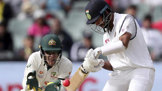 India's Cheteshwar Pujara bats on day 1 of the first Test match against Australia in Adelaide.(AP)