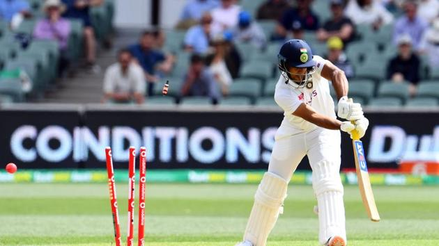 India's Mayank Agarwal is clean bowled by Australia's paceman Pat Cummins on day one of the first cricket Test match between Australia and India in Adelaide on December 17, 2020.(AFP)