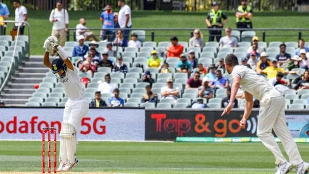 Indian batsman Cheteshwar Pujara avoids a ball on day one of the first cricket Test match between Australia and India in Adelaide on December 17, 2020.(AFP)