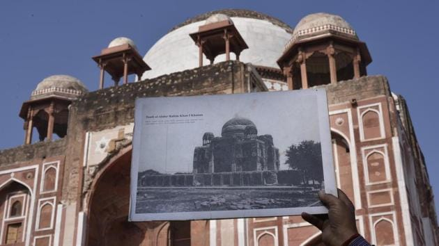 A person holds an old photograph of the Tomb of Abdur Rahim Khan-i-Khanan also known as Rahim's Tomb, to draw comparison after the completion of its restoration work, near Nizamuddin, in New Delhi on Wednesday.(Vipin Kumar/HT PHOTO)