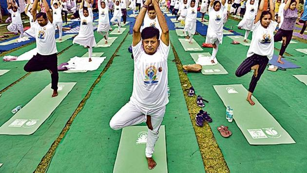 People performing yoga marking on International Yoga Day at Lodhi Gardens in New Delhi.(Sanchit Khanna/HT File Photo)