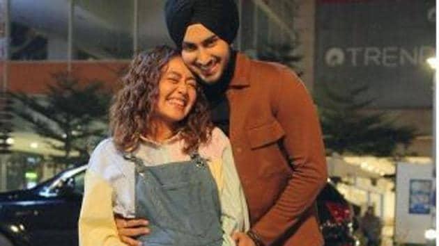 Neha Kakkar poses with husband Rohanpreet Singh.