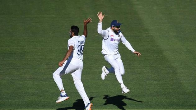 Indian captain Virat Kohli reacts with bowler Ravichandran Ashwin (L) on day 2 of the first test match between Australia and India at Adelaide Oval, Adelaide, Australia, December 18, 2020.(REUTERS)