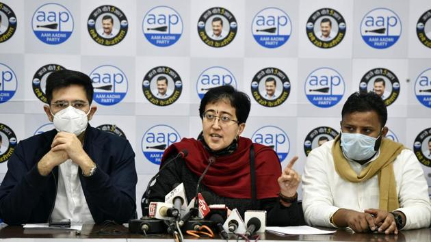 New Delhi, India - Dec. 13, 2020: Aam Aadmi Party (AAP) MLA Atishi (C) and Raghav Chadha (L) during a press conference at the party office, in New Delhi, India, on Sunday, December 13, 2020. (Photo by Sanjeev Verma/ Hindustan Times)
