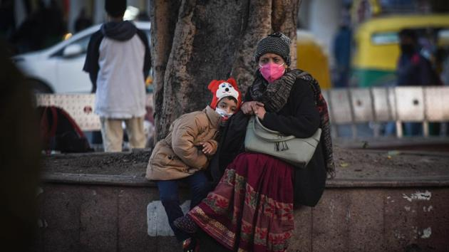 "A woman and child wearing face masks while out on a winter day at Connaught Place in New Delhi on December 17. The ministry also said that India's recovery rate is among the highest in the world. ""While the global figure for Recovery Rate is 70.27%, India is recording 95.31%. USA, Brazil, Russia, and Italy are reporting lesser recovery rates,"" it said. (Sanchit Khanna / HT Photo)"