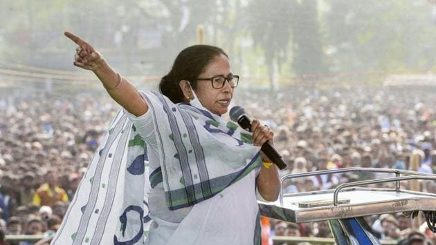 West Bengal Chief Minister Mamata Banerjee addresses during a rally at Rashmela Ground in Cooch Behar district, Wednesday, Dec. 16, 2020. (PTI Photo)