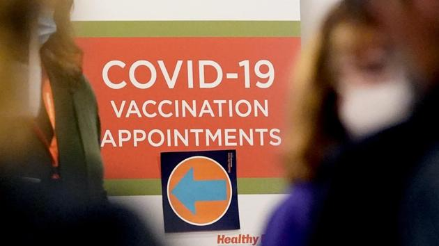 A Covid-19 vacation appointments sign points the way at Edward Hospital in Naperville, Ill., Thursday.(AP Photo)