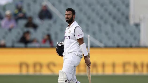 India's Cheteshwar Pujara walks off after he was caught out for 43 runs against Australia in 1st innings during their cricket test match at the Adelaide Oval in Adelaide.(AP)