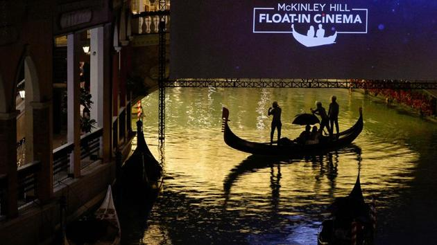 People ride on a gondola before a movie begins at a float-in cinema.(REUTERS)