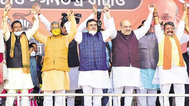 Union Home Minister Amit Shah along with party leaders during an election rally ahead of West Bengal Assembly polls 2021, in West Midnapore district, Saturday, Dec. 19, 2020.(PTI)