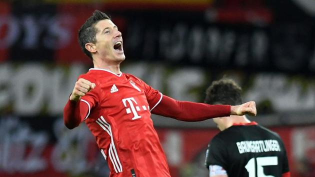 Soccer Football - Bundesliga - Bayer Leverkusen v Bayern Munich - BayArena, Leverkusen, Germany - December 19, 2020 Bayern Munich's Robert Lewandowski celebrates scoring their second goal Pool via REUTERS/Bernd Thissen DFL regulations prohibit any use of photographs as image sequences and/or quasi-video. TPX IMAGES OF THE DAY(Pool via REUTERS)