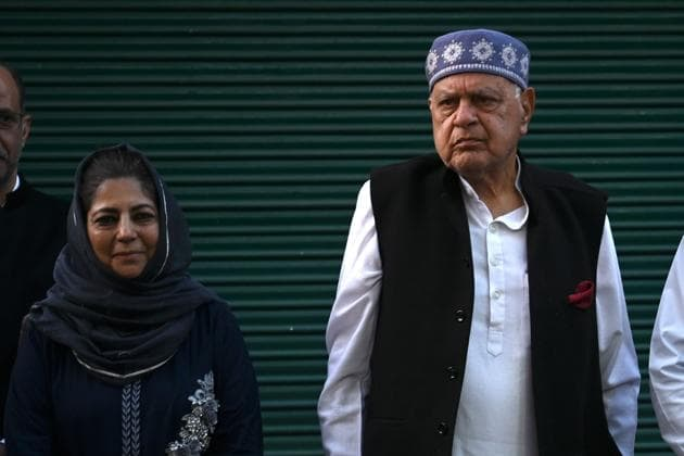 Jammu and Kashmir National Conference president Farooq Abdullah (R) poses along with former chief minister Mehbooba Mufti after a meeting in Srinagar on October 15.(AFP FILE)
