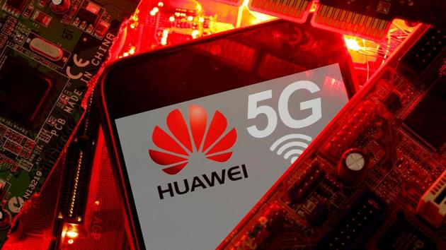 A smartphone with the Huawei and 5G network logo is seen on a PC motherboard.(REUTERS)