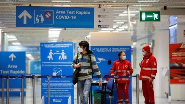 A passenger walks at Fiumicino airport after the Italian government announced all flights to and from the UK will be suspended over fears of a new strain of the coronavirus in Rome on December 20, 2020.(Reuters Photo)