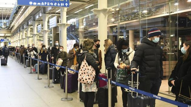People at St Pancras station in London, wait to board the last train to Paris, on Sunday. British Prime Minister Boris Johnson said Saturday that holiday gatherings can't go ahead and non-essential shops must close in London and much of southern England.(AP Photo)