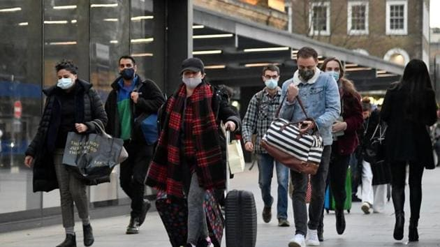 Travellers walk outside of King's Cross station as the British government imposes a stricter tiered set of restrictions amid the coronavirus disease pandemic, in London on December 20.(Reuters Photo)
