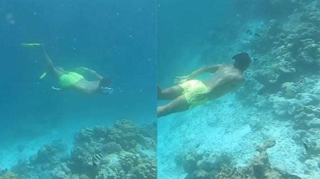 Milind Soman swimming underwater in the Maldives.
