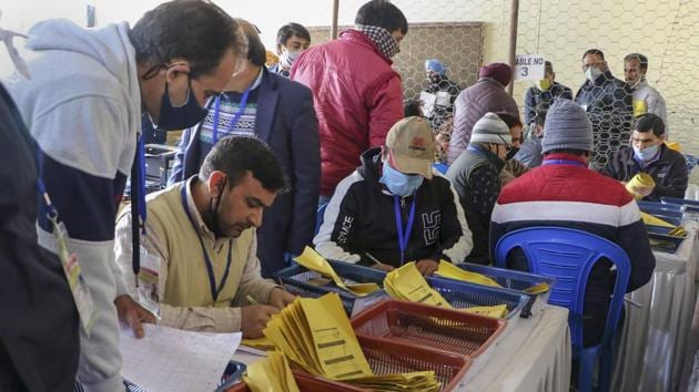 Jammu: Counting of votes for the recently concluded District Development Council elections in progress at a centre, in Jammu, Tuesday, Dec. 22, 2020. (PTI Photo)