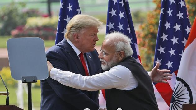 FILE - In this Feb. 25, 2020 file photo, U.S. President Donald Trump and Indian Prime Minister Narendra Modi embrace after giving a joint statement in New Delhi, India. (AP Photo/Manish Swarup, File)