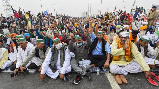Farmers during a protest march against the Centre's agri-laws, at Delhi-Meerut Expressway in New Delhi, Friday.(PTI)