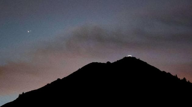 Jupiter and Saturn appear about one-tenth of a degree apart during an astronomical event known as a Great Conjunction above Mt. Tamalpais in Larkspur, California.(AP)