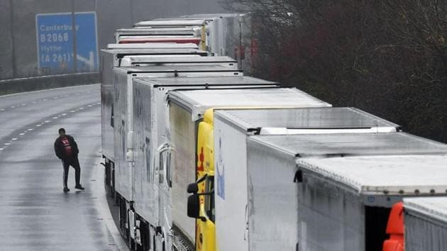 Trucks bound for the continent are lined up on the M20 motorway outside Dover, Britain's busiest ferry port, after a new coronavirus strain prompted France on Sunday to bar drivers from crossing the Channel(REUTERS)