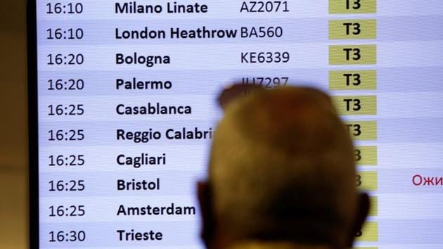 A passenger looks at a flight board at Fiumicino airport after the Italian government announced all flights to and from the UK will be suspended over fears of a new strain of the coronavirus, amid the spread of the coronavirus disease in Rome, Italy.(REUTERS)