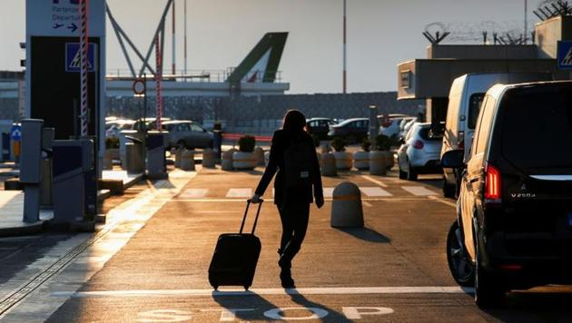 A passenger walks at Fiumicino airport after the Italian government announced all flights to and from the UK will be suspended over fears of a new strain of the coronavirus, amid the spread of the coronavirus disease in Rome, Italy.(REUTERS)