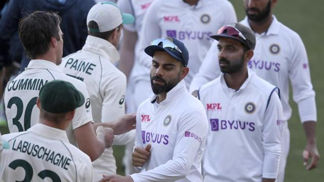 India's Virat Kohli, center, shakes hands with Australian players on the third day of their cricket test match at the Adelaide Oval in Adelaide, Australia, Saturday, Dec. 19, 2020. Australia won the match. (AP Photo/David Mariuz)(AP)