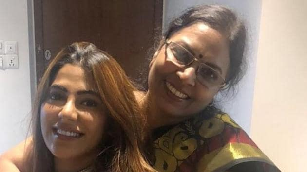 Nikki Tamboli poses with her mother.