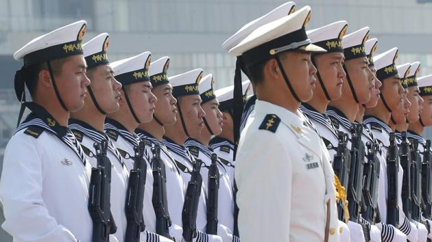 In this January 17, 2019, file photo, Chinese People's Liberation Navy sailors stand in formation on the deck of a type 054A guided missile frigate Wuhu as it docks at Manila's South Harbour for a four-day port call in Manila, Philippines.(AP/ FILE)